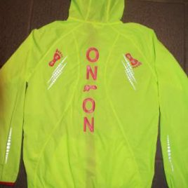 Ladies running jacket in strong neon yellow with pink print, zip and lines